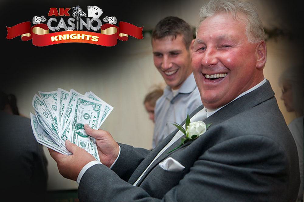 Men winning money at the wedding casino tables